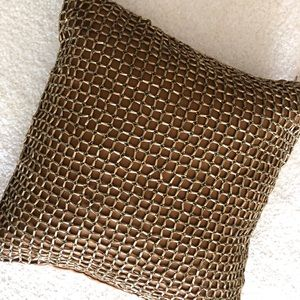 Gold decorative chain design accent pillow